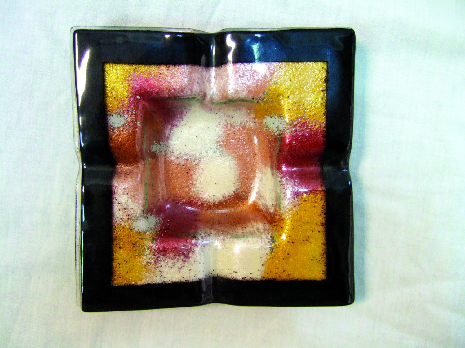 Fused glass metallic dust ashtray