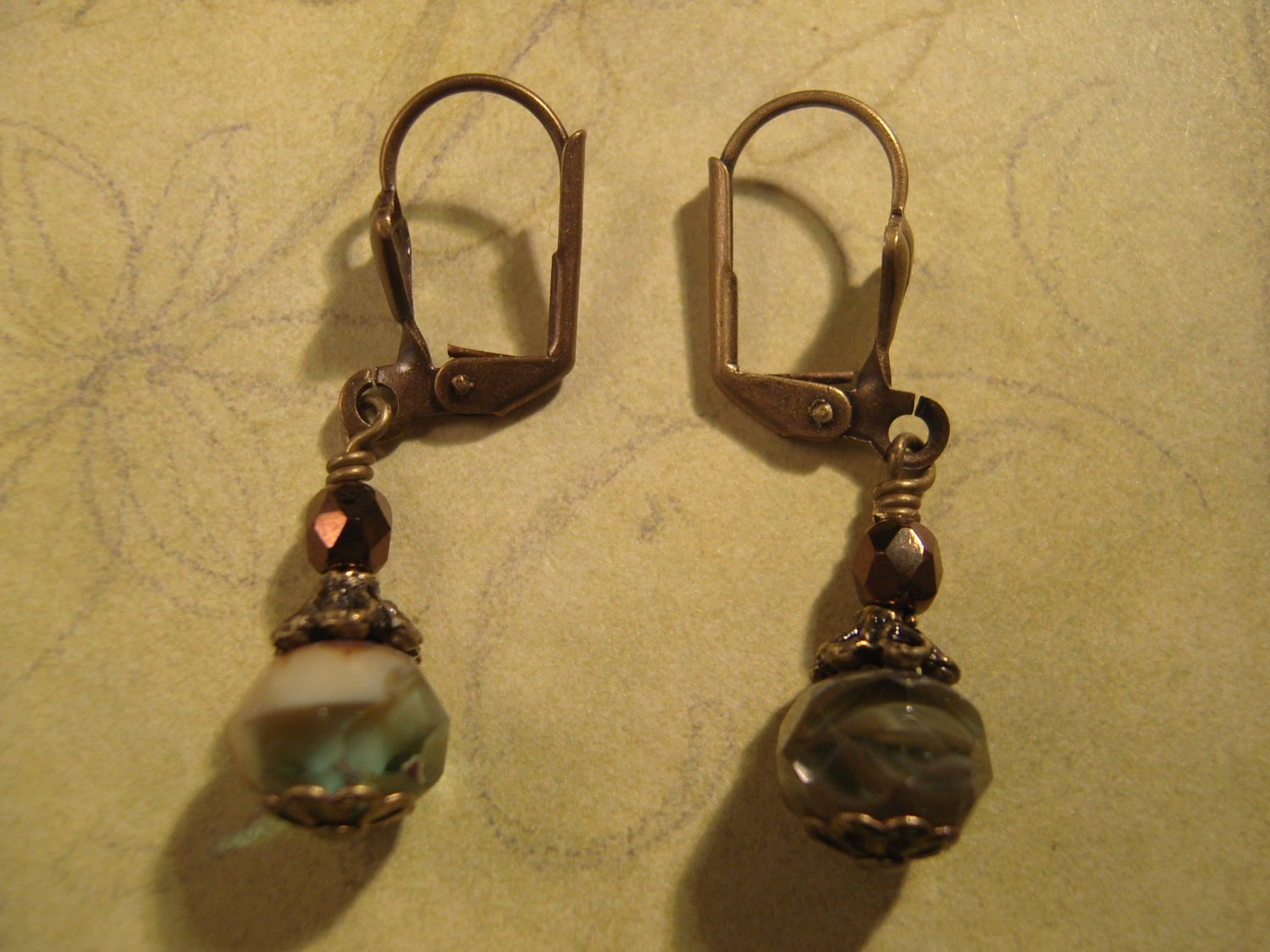 Ivory and Blue Spruce Picasso Bead and Antique Brass Earrings