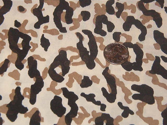 "Camoflauge in Black and Tan Sheeting Fabric   39""L x 92""W"