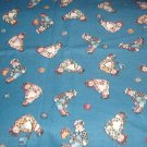 "Raggedy Dolls and Buttons on Blue Fabric 36""w x 3/4 yd"