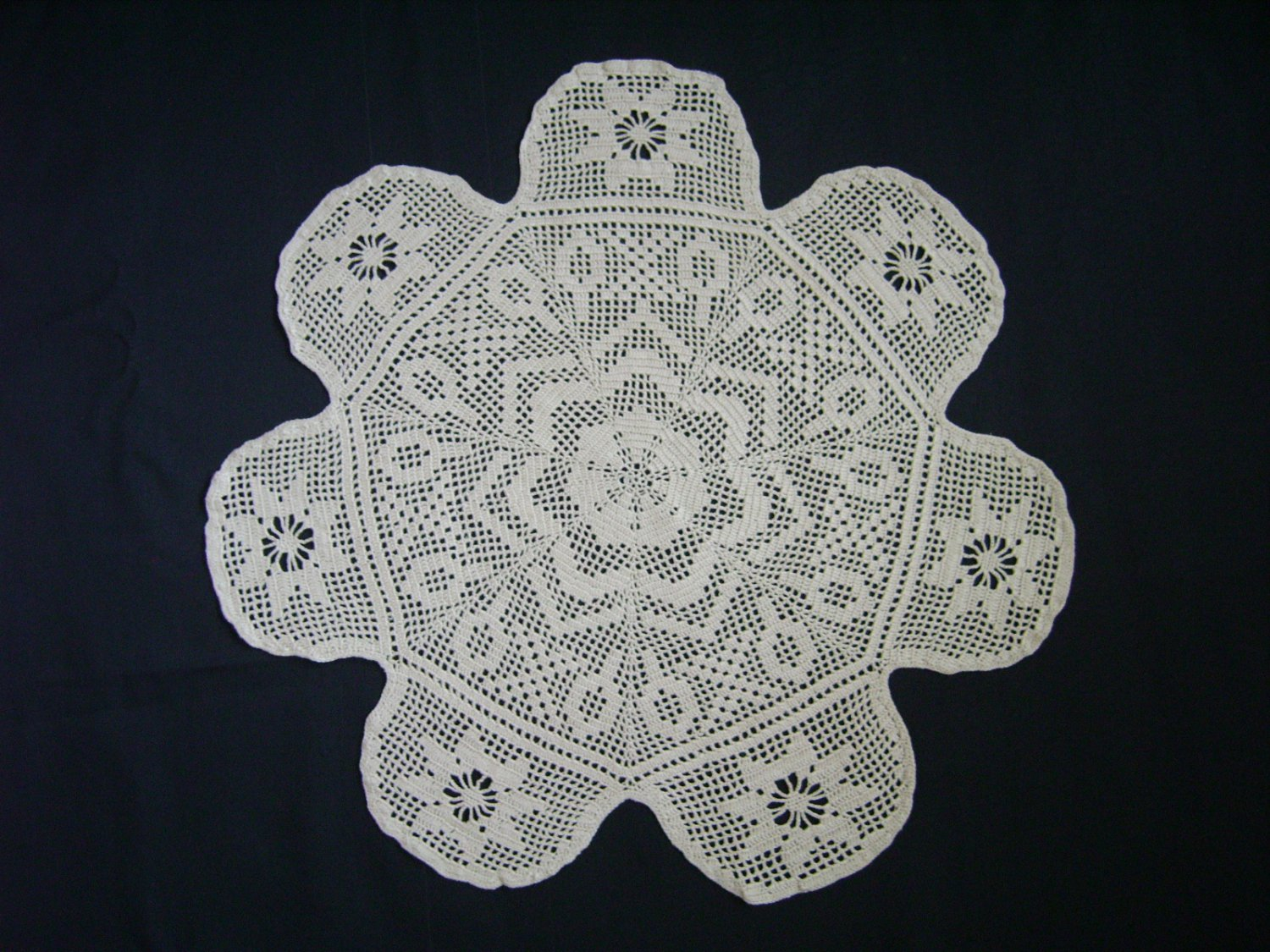 Hand crocheted ecru rainbow star doily.