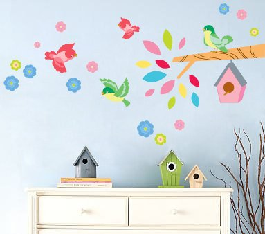 Kids tree branch with hanging bird house flowers and birds