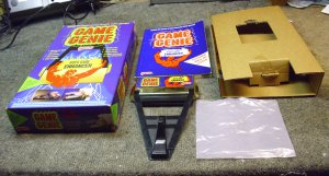 Game Genie 7356 by Galoob, video game enhancer, and cheats, for the NES game system.