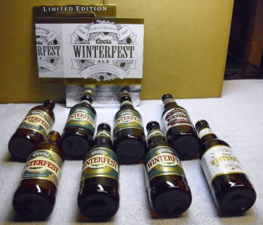 Coors Winterfest series 1987-1997 (8) beer bottles with one 6 pack carton.