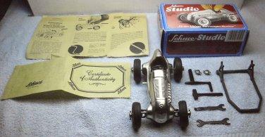 Schuco Studio 1050 Merecedes Grand Prix 1936 #4 Silver windup toy hobby die cast car, W Germany.