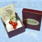 Edgar Berebi, Cherry Jubilee brooch pin, signed first folio edition, with box and insert.
