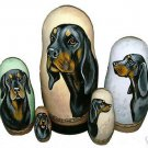 Black and Tan Coonhound on Five Russian Nesting Dolls.  Dogs