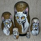 Sphynx Cat on Five Russian Nesting Dolls.