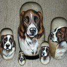 Deutscher Wachtelhund (German Spaniel) on Five Russian Nesting Dolls. Dogs.