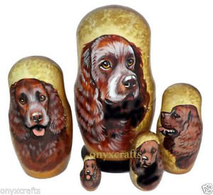 American Water Spaniel on Five Russian Nesting Dolls. Dogs