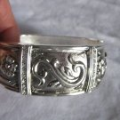 Silver cuff with rhinestones and flowers