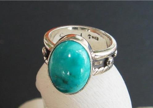 Turquoise ring 15mm on sterling silver holder