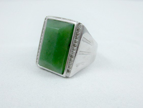 Jade square surface. Antique Tibetan silver inlay green jade ring. Selection of a successful man