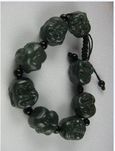 Double-sided hand-woven bracelet Buddha's head. Chinese black jade. Hand-carved.
