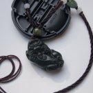 Natural dark green jade, hand-carved brave. Pendant
