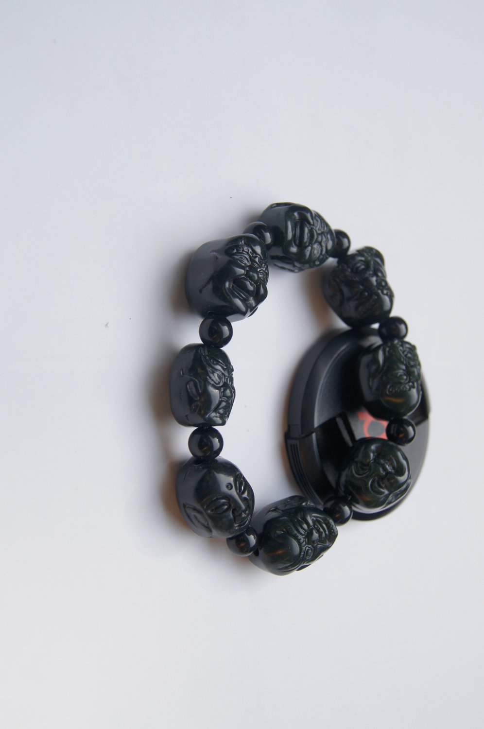 Hand-carved black jade Buddha Lohan head, rubber band string bracelet. Successful men's favorite