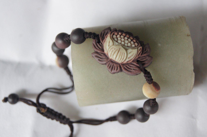 Natural purple robe jade, hand-carved.Weaving.Lotus (auspicious) bracelet.