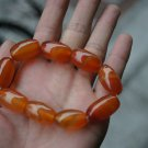 Natural light red flying white (agate).9 drum-shaped beads. The rubber band strung together.