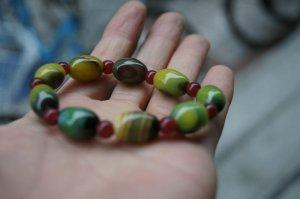 Natural multicolor (agate), hand-carved, nine drum beads.. Bracelet.