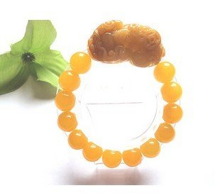 Natural yellow jade bracelet. Hand-carved brave, topaz bead bracelet.