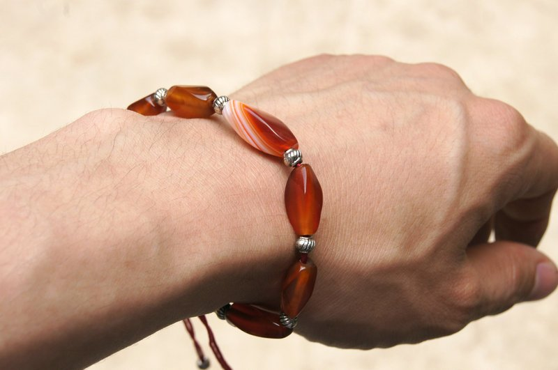 Natural red agate. The multi-faceted agate beads 7 +10 Tibetan silver lantern. Hand-woven bracelet.