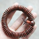 The sandalwood peace deduction, plus a Buddha head beads, prayer beads, bracelets
