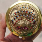 National style, copper alloy / inlaid with precious stones, vintage make-up mirror, peacock