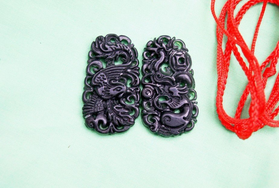 Recorded in an empty the openwork, dark green emerald.(Fengpei), couple necklace (one pair price)
