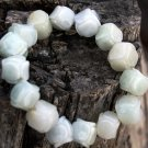 Natural white jade bracelet. Hand-carved surface saddle-shaped, 15 beads. Rubber band tension.