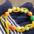 Color (jade) beads 10 mm 6 of +8 mm 8 beads + green beads hand-woven (bracelets).
