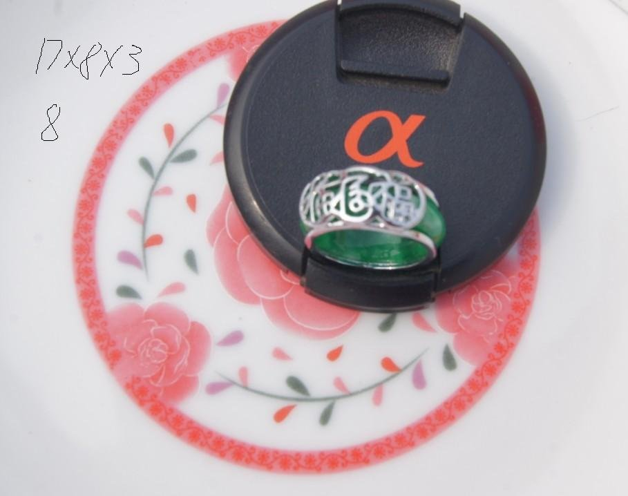 The alloy (fu) is inlaid with green jade rings. The vintage ring is about  17x8x3 mm