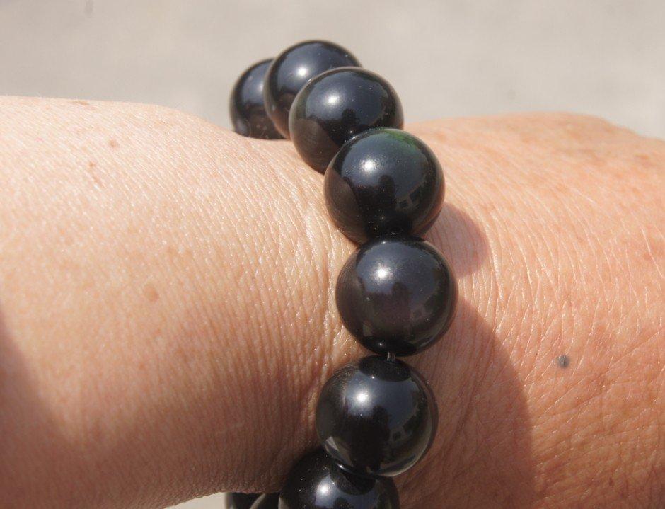 Natural obsidian bracelet. 16 mm 13 yuan beads. Rubber band strung.