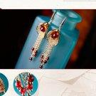 Gold plated alloy garnet tassel long retro anti allergic stud earrings. The choice of beauty