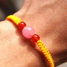 Bracelet with the yellow flat knot pink jade round bead nao beads lucky bracelet
