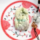 The natural color of jade, made by hand, and the two toads. Vintage necklace pendant