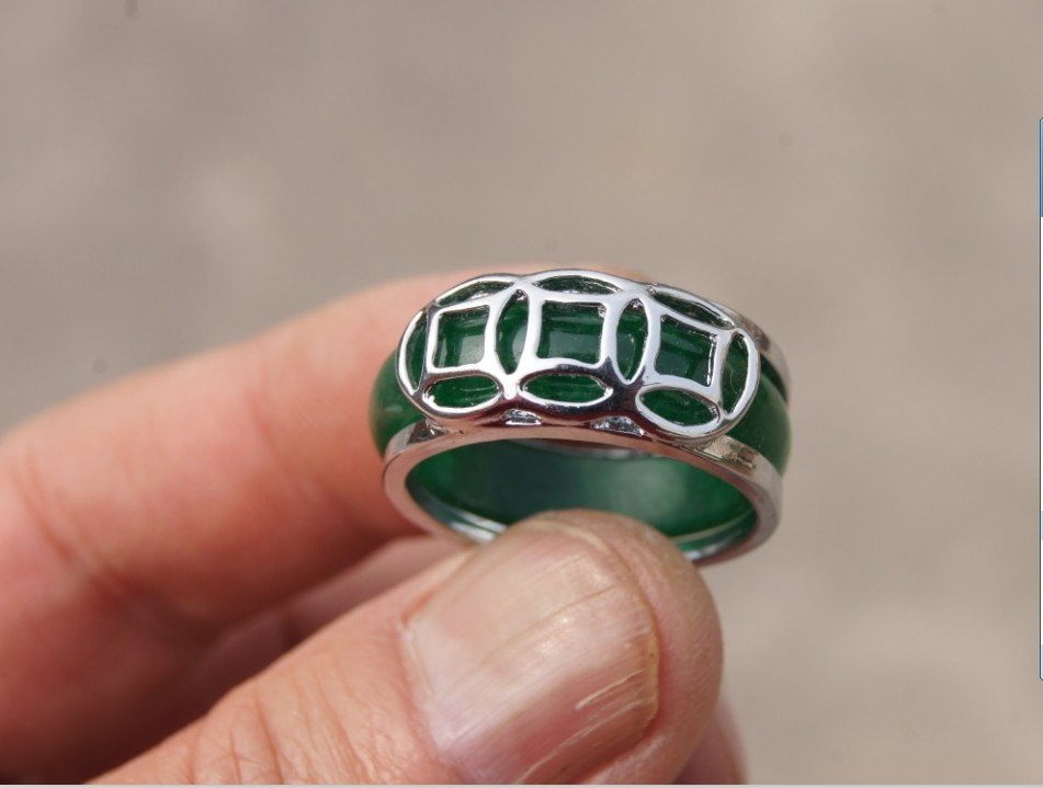 The alloy (currency) is studded with green jade rings. The ring is about 18 x7x3 mm.