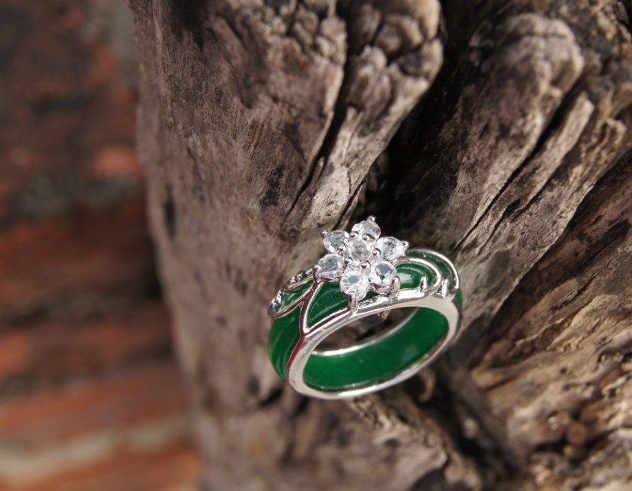 Alloy (plum blossom) green jade inlaid ring. The antique charm ring is about 17 x 7x3 mm.