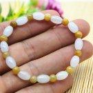 Natural bag (jade), handmade carving, drum beads (bracelet). Elastic string