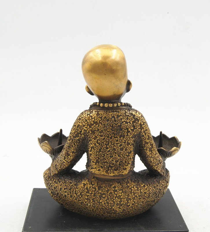 Vintage bronze burner for the lighting of Buddha. Antique decorative ornaments.