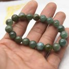 Handmade natural dark green agate beads, 10 mm 18. The rubber bands form a charm bracelet.