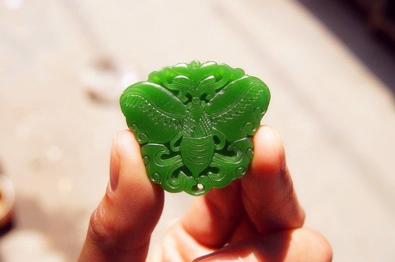 Hand-carved Mongolian jade butterfly, elliptical talisman necklace pendant.