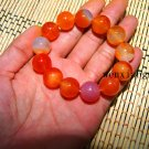 Natural red agate beads. The single bead is about 16 mm in diameter and forms a bracelet.