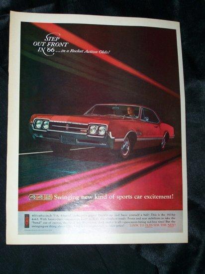 Vintage 1965 OLDSMOBILE Olds Red Rocket Action Print Ad