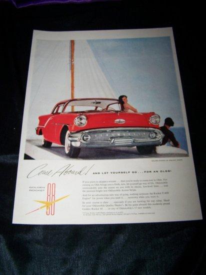 Vintage 1957 Oldsmobile Golden Rocket Holiday Print Ad