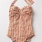 Traje baño crema con polka dots rojos completo