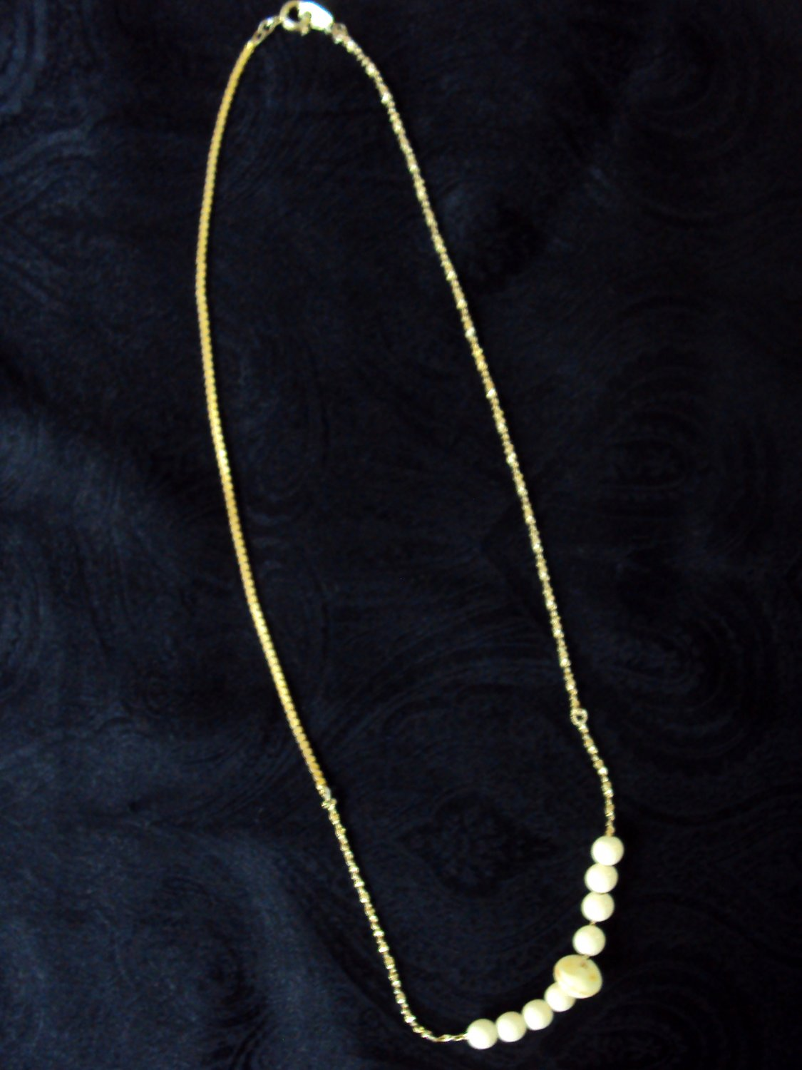 Asymmetrical necklace with cream colored beads, 18 1/2 inches