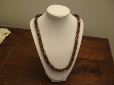 Kumihimo beaded necklace 23.5 in in brown,gold,amber tones