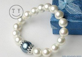10 mm and 14 mm white pearls and drill bracelet (A126)