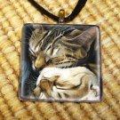 Cat in a mirror pendant
