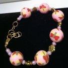 polymer clay bracelet featuring butterflies & matching pink glass beads